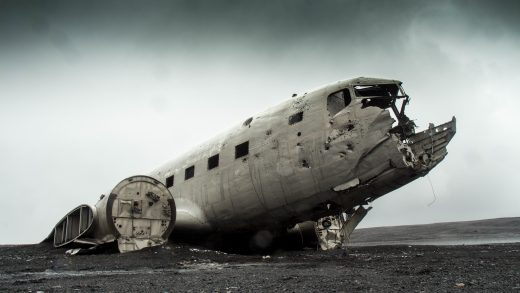 Derelict plane in wasteland, a vagrant's shelter.
